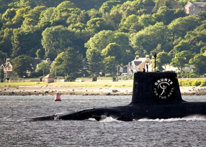 A submarine, emerging from the water with the Grunts for the Arts logo emblazoned on the side